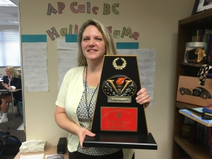 Mrs. Brown holds the JV second place trophy.