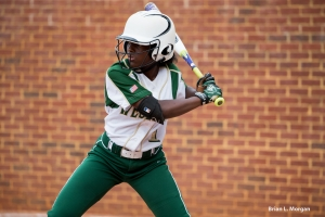 Freshman Jahni Kerr slaps at the plate against Mt. Pisgah.