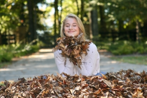 Spencer Sutlive- Payton Kaloper enjoys jumping in a leaf pile