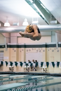 Senior Captain, Abby Gardner, performs a pike dive at a recent diving meet.